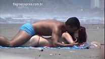 Shameless couple try to have sex on the beach without attracting attention