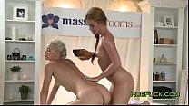 Blonde masseuse massages naked brunette Vorschaubild