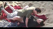 couple having sex on the beach video