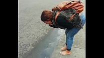 Colombian puta barefoot and vomit in public in the street