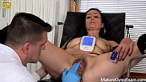 Hot mature brunette Alla Minx made to cum in gyno chair by 2 kinky doctors