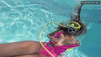 Cute teen Irina Poplavok swims naked underwater
