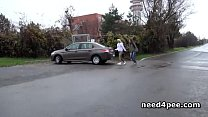Teen girlfriends pissing behind a parked car Preview