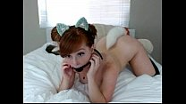 Redhead Girl puts a kitten tail in the ass and gag in mouth on cam porn image