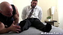 Muscular master licks his bound buddies feet and tickles him