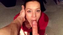 Milf on her knees sucking cock chokes down cum load