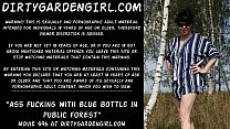 Ass fucking with blue bottle in public forest