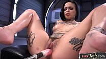 Inked babe orgasms after machine sex