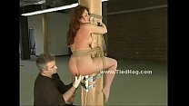 Sex slave bound in leather bdsm