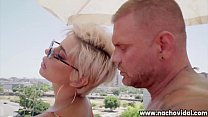 With her short blond hair the thick and voluptu...