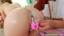 Squirting milk enema lover