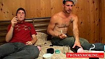 Buddies really love to smoke and stroke cocks in the bedroom