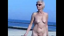 Cute hot granny fully naked at beach. Public nudity porn image
