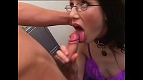 Dazzling brunette in glasses gets her cute face covered in cum after giving a blowjob