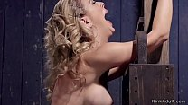 Clamped blonde in upside down position