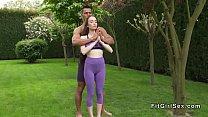 Couple doing yoga in backyard before sex
