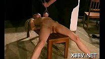 Obedient honey stands and endures heavy breast bondage porn
