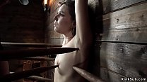 Brunette is spanked in device bondage