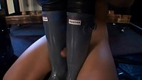 Slave worships 2 women in their hunter boots