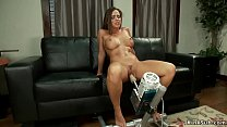 Busty babe has intense orgasm on machine