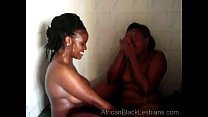 African hottie gets orally pleased by a chunky sista in the showerathroom-1
