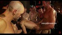 Dirty gay men gather around slave