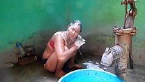 Indian house wife bathing front of her husband