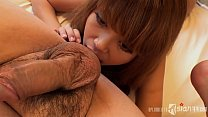 Cute Asian whore is sucking balls on camera