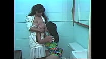 Two gorgeous Latins with nice tits lick each other's pussies in the bathroom