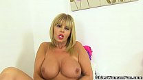 English milf Gabby Fox fingers her fanny on toilet preview image