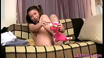 This teen Lil Emma has her hair in pigtails while she fingers herself to an orgasm