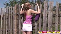 Sweet teenie pleasuring herself outdoors