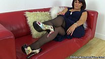 UK milf Christina X stuffs her pussy with a big black dildo