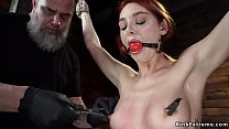 Redhead in hogtie suspension pussy toyed