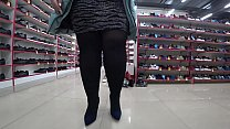 A foot fetish in a public place and a fetish with peeping under a short skirt. BBW with a big ass in a shoe store.