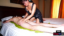 Amateur MILF gives a Thai massage with happy end to her big cock customer