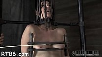 Gagged beauty's bawdy cleft is being screwed viciously by hard rod image