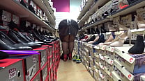 Chubby legs in nylon trying on high heels in a public shoe store. Foot fetish and a gorgeous big ass.