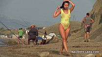 Transparent swimsuit and nude on the beach صورة