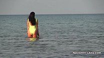 Transparent swimsuit and nude on the beach Vorschaubild