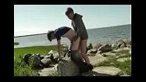 2 young guys having sex by the shoreline