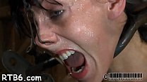 Fastened up beauty receives tongue and facial torture