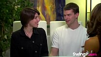 Young couple enjoying their first swinger party image