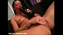 Image: Carmen stretches her tight pussy with a humongous dildo