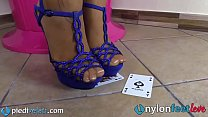 Blonde uses feet in pantyhose to play cards