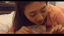 Cute Asian teen girl is sucking cock in a hotel...