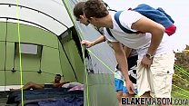 Young outdoor lovers threesome fucking in a camping tent
