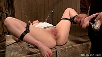 Brunette in tormented in bdsm chair