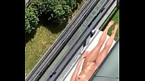 Neighbor sunbathing on the balcony