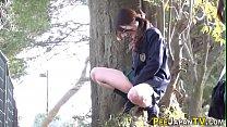 Asian teens in uniform urinate
